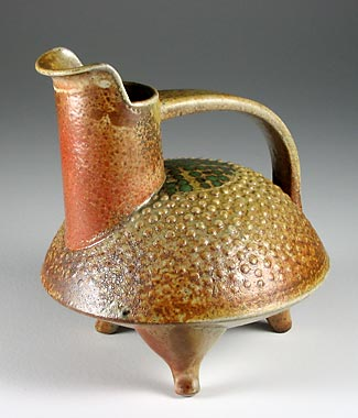 Wood fired pouring vessel